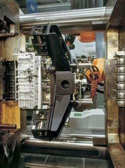 Removal of crankcase from die casting machine